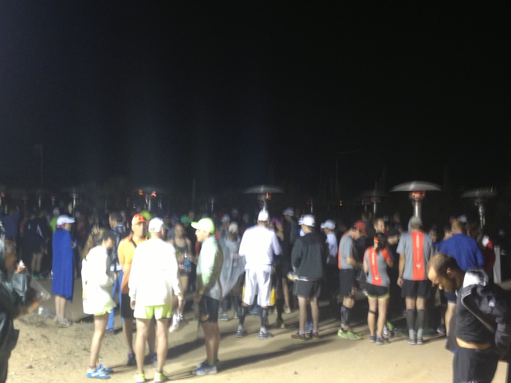 Runners keeping warm at the start