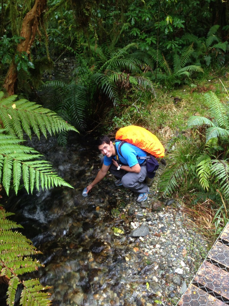 MIke filling up our water bottles from the river - all river water is safe to drink!
