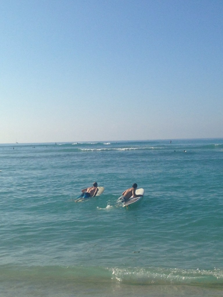 Mike and Sam's husband AJ paddling out for a morning surf