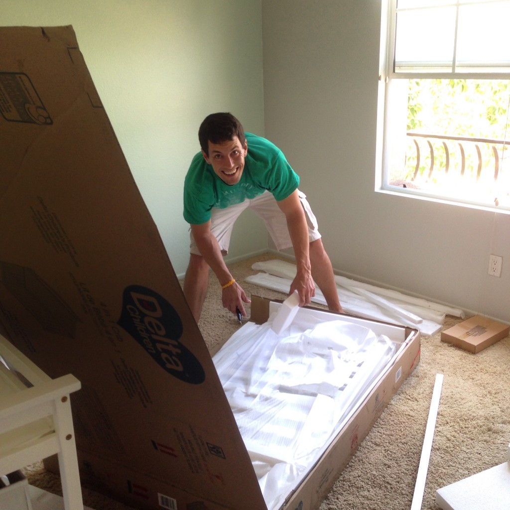 Mike putting together the crib the day after we painted the room.
