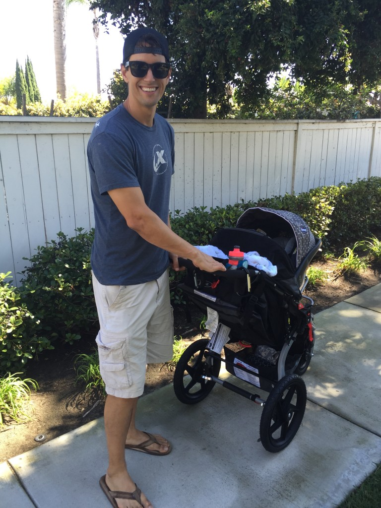 Daddy pushing the stroller on our first outing