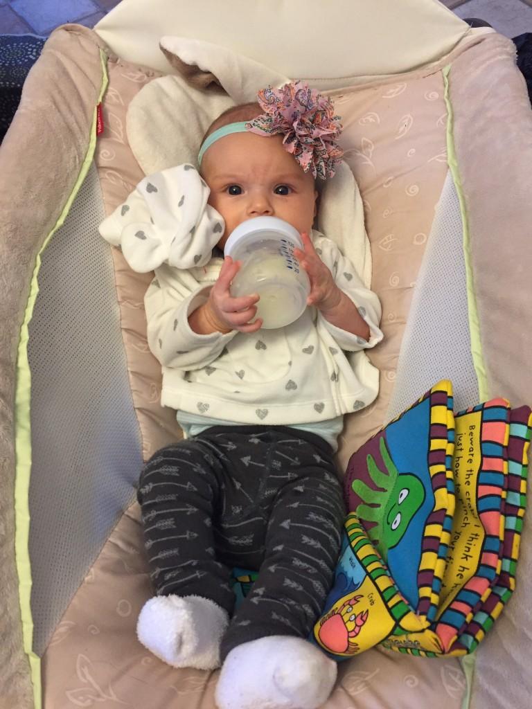 Sometimes she even holds her own bottle!